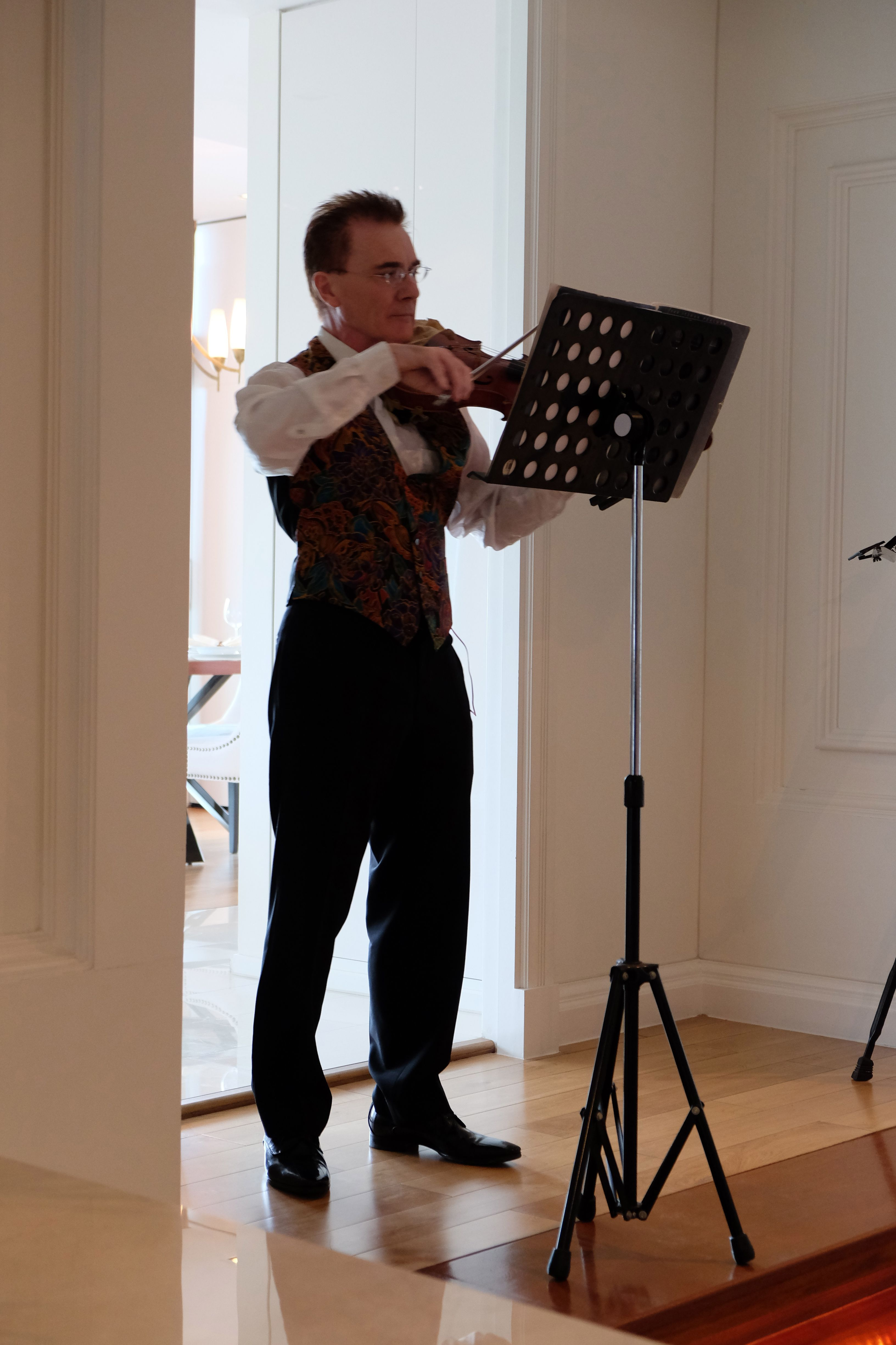 Lawrence rounds off a violin student's concert in Bangkok, with a short solo.